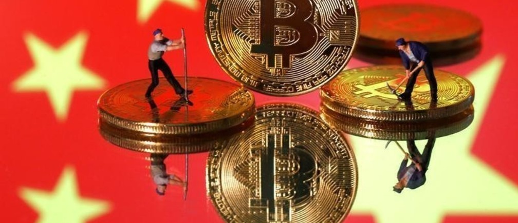 Small toy figurines are seen on representations of the Bitcoin virtual currency displayed in front of an image of China's flag in this illustration picture, April 9, 2019. REUTERS/Dado Ruvic/Illustration - RC1C8B3510C0