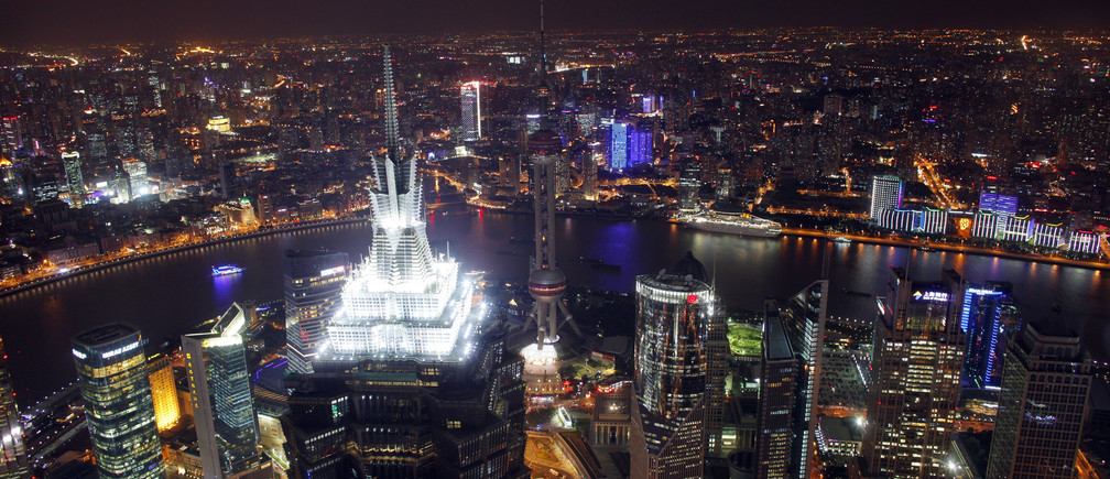 A view of the city skyline from the Shanghai Financial Center building, October 25, 2011. The world's population will reach seven billion on October 31, 2011, according to projections by the United Nations. REUTERS/Carlos Barria  (CHINA - Tags: SOCIETY CITYSPACE) - GM1E7AP1OAS01
