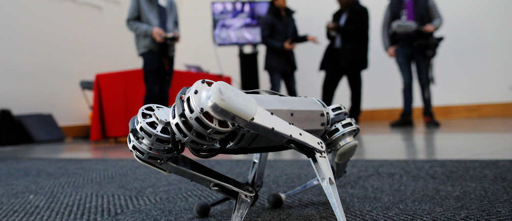 Students demonstrate the Mini Cheetah, a quadruped robot, during presentations to celebrate the newMIT Stephen A. Schwarzman College of Computing at the Massachusetts Institute of Technology in Cambridge, Massachusetts, U.S., February 26, 2019.   REUTERS/Brian Snyder - RC1200981130