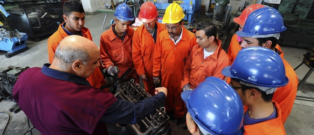 An instructor teaches trainees at a maritime transport training centre.