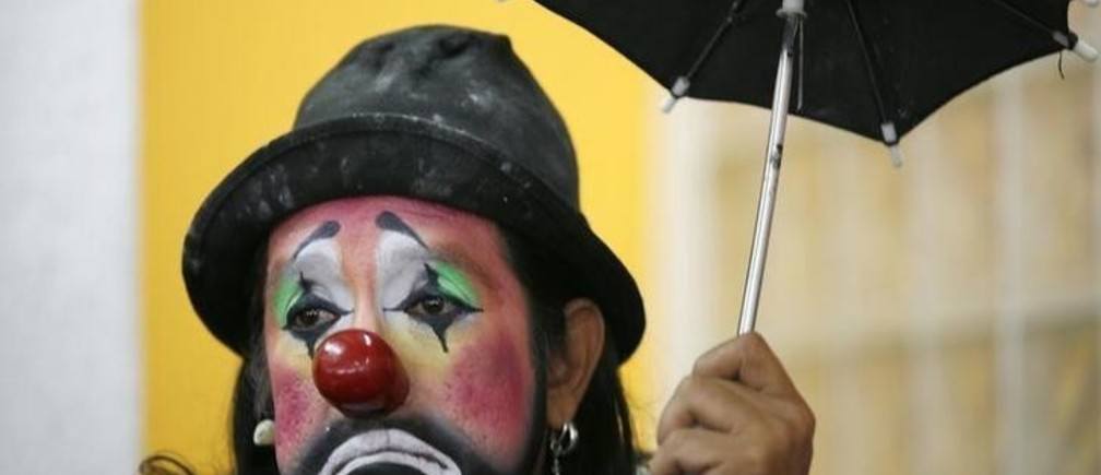A clown looks on during a news conference in Mexico City October 14, 2009. Mexico will host the 14th Latin American Clown Convention from October 19 to October 22. REUTERS/Eliana Aponte (MEXICO SOCIETY)