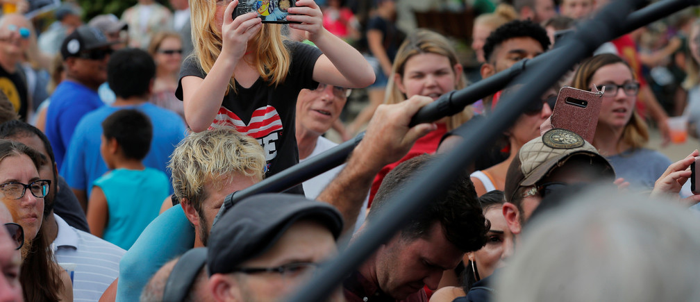 A girl records with a mobile phone as Democratic 2020 U.S. presidential candidate U.S. Senator Bernie Sanders arrives at the Iowa State Fair in Des Moines, Iowa, U.S., August 11, 2019.    REUTERS/Brian Snyder - RC12341AE4C0