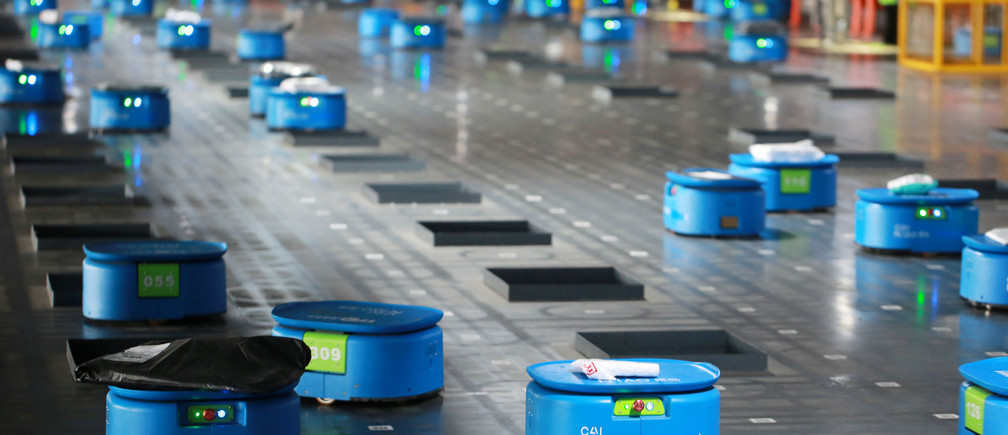 Robots operated by Alibaba's logistics unit Cainiao, move parcels at a new automated guided vehicles (AGV) warehouse inside the hub of delivery company YTO Express, in Hangzhou, Zhejiang province, China September 14, 2018. Picture taken September 14, 2018. REUTERS/Stringer ATTENTION EDITORS - THIS IMAGE WAS PROVIDED BY A THIRD PARTY. CHINA OUT. - RC1BFA09B070