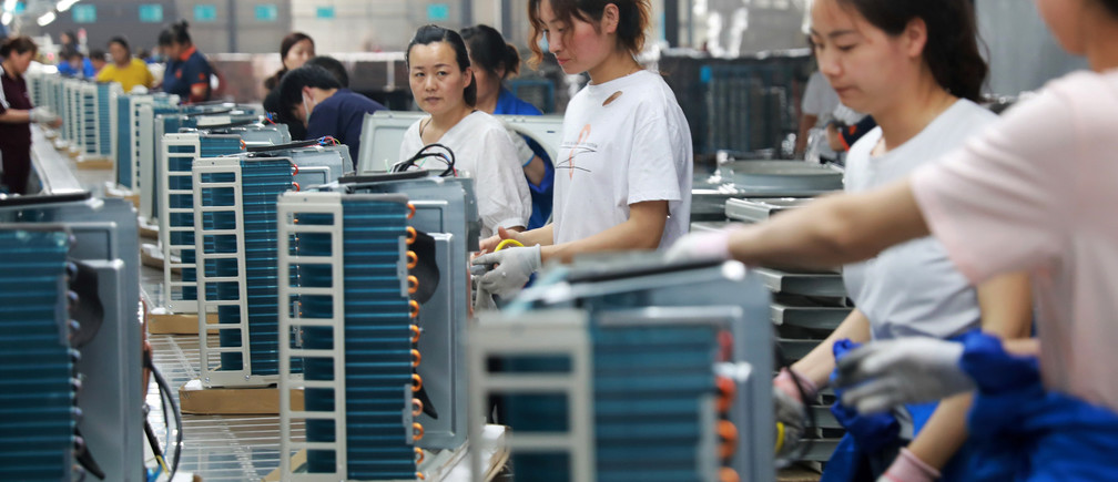 Women work on a production line manufacturing air conditioners, at a factory of an electrical engineering company in Huaibei, Anhui province, China May 30, 2019. REUTERS/Stringer ATTENTION EDITORS - THIS IMAGE WAS PROVIDED BY A THIRD PARTY. CHINA OUT.