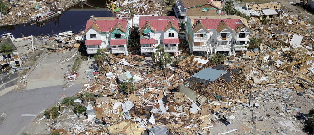Aerial photo shows damaged and destroyed homes after Hurricane Michael smashed into Florida's northwest coast in Mexico Beach, Florida, U.S., October 12, 2018. Picture taken October 12, 2018. REUTERS/Dronebase  MANDATORY CREDIT. TPX IMAGES OF THE DAY - RC17EB29B8F0