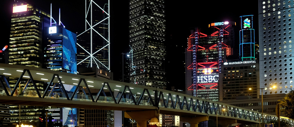 Commercial towers light up in the evening at the financial Central district of Hong Kong, China August 8, 2017.  REUTERS/Bobby Yip - RC1C71DE6BB0