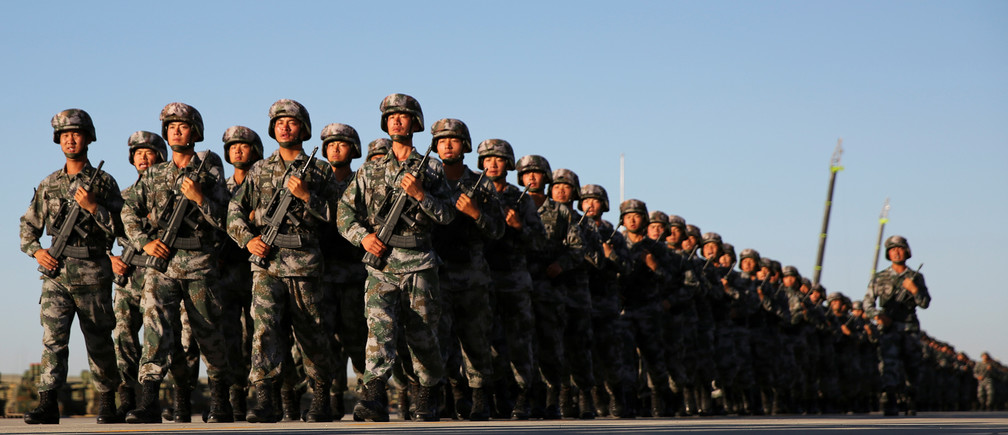 Soldiers arrive for a military parade to commemorate the 90th anniversary of the foundation of China's People's Liberation Army (PLA)  at the Zhurihe military training base in Inner Mongolia Autonomous Region, China, July 30, 2017. REUTERS/Stringer ATTENTION EDITORS - THIS IMAGE WAS PROVIDED BY A THIRD PARTY. CHINA OUT. NO COMMERCIAL OR EDITORIAL SALES IN CHINA. - RC1A4C86AD40