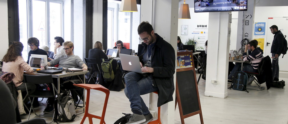 "Entrepreneurs work at their computer laptops at the so-called ""incubator"" of French high-tech start-ups ""Numa"" in Paris, France, in this March 11, 2016 file photo."