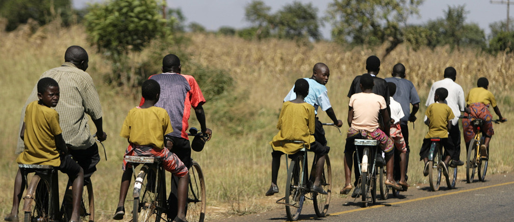 Schoolchildren are transported along the Mchinji road-the highway linking Malawi to Zambia's eastern province, April 21, 2008.