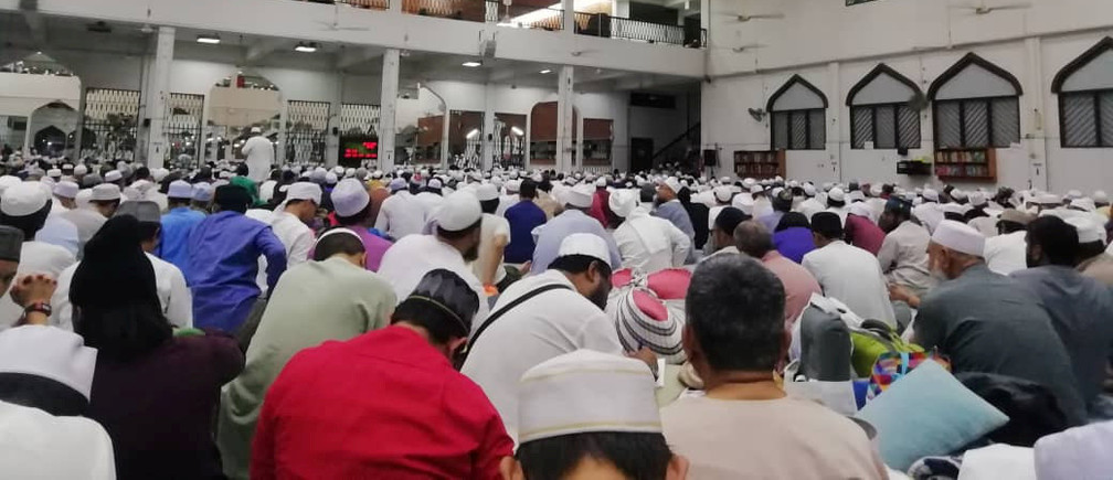 Crowd of people gather at Seri Petaling Mosque, a presumed hotspot for coronavirus disease (COVID-19) outbreak, in Kuala Lumpur, Malaysia, February 29, 2020 in this picture obtained by Reuters from social media on March 19, 2020.