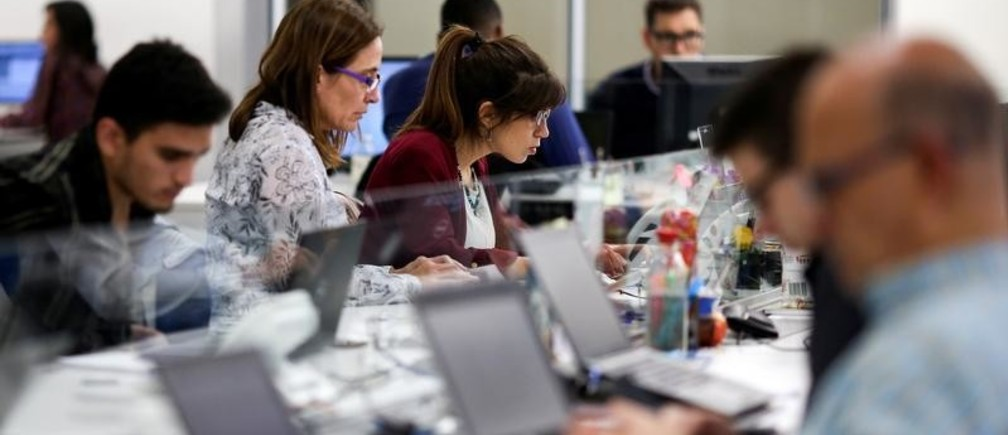 Employees work at the Wilobank offices in Buenos Aires, Argentina March 20, 2019. Picture taken March 20, 2019. REUTERS/Agustin Marcarian - RC128EA55C70