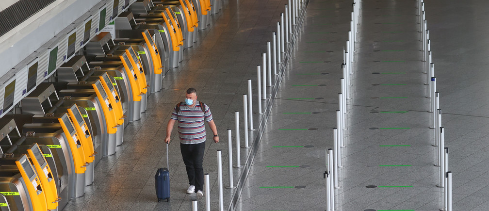 A traveler is seen at the airport in Frankfurt, Germany, May 20, 2020, as the spread of the coronavirus disease (COVID-19) continues. REUTERS/Kai Pfaffenbach - UP1EG5K0RQ92D