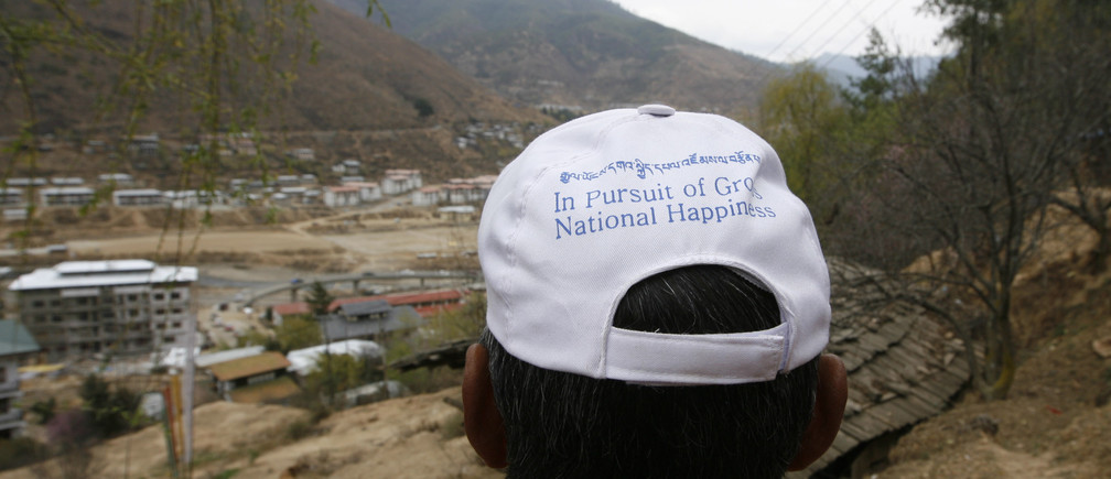 A member of the new party 'Druk Phuensum Tshogpa' (DPT) wears a cap with the motto of the party, 'In pursuit of Gross National Happiness' during their election campaign in the capital Thimpu March 20, 2008. Bhutan will go to the polls for the first time on March 24. REUTERS/Desmond Boylan (BHUTAN) - GM1E43L069P01