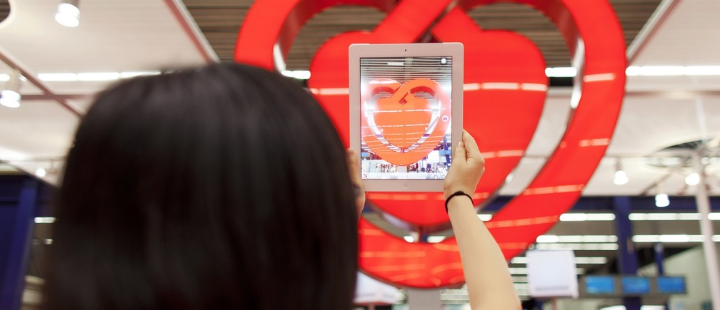A participant takes a picture of a heart-shaped structure with a tablet device at the European Society of Cardiology meeting venue in Amsterdam September 2, 2013.