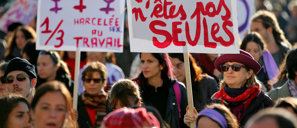 """Demonstrators attend a rally against the gender-based and sexual violence against women in Marseille, France, November 24, 2018. The banners read """"You are not alone"""" and """"harassed at work"""". REUTERS/Jean-Paul Pelissier - RC14B3245570"""