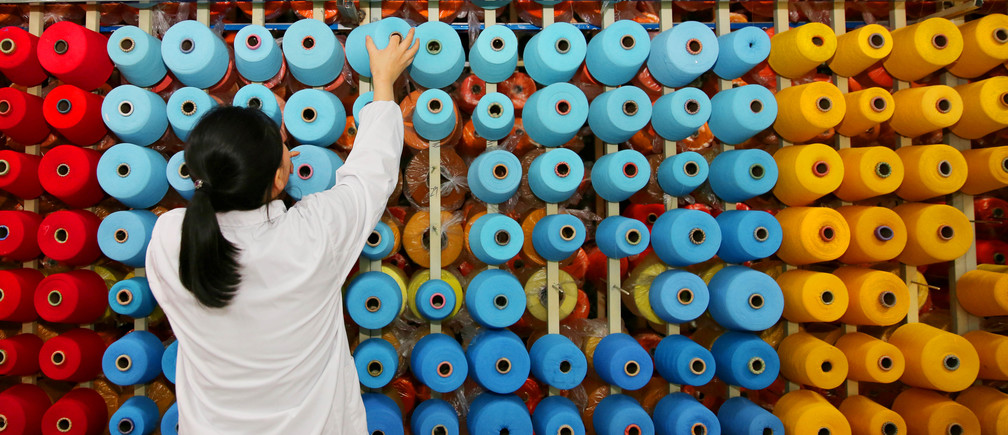 An employee arranges bobbins at a textile plant in Haian county, Jiangsu province, China November 28, 2017. China Daily via REUTERS  ATTENTION EDITORS - THIS IMAGE WAS PROVIDED BY A THIRD PARTY. CHINA OUT.      TPX IMAGES OF THE DAY - RC1D8928ACA0