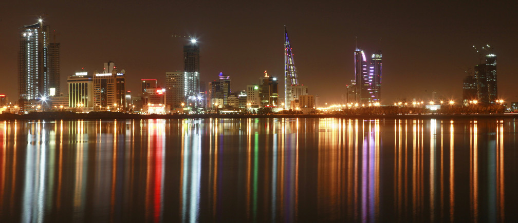A view of the skyline of Manama at night October 20, 2010.  REUTERS/Hamad I Mohammed (BAHRAIN - Tags: CITYSCAPE) - GM1E6AL0IPR01