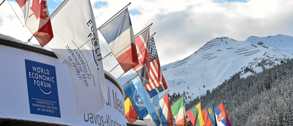 View of the Congress Center with the flags in front of snowy mountains ahead of the Annual Meeting 2016 of the World Economic Forum in Davos, Switzerland, January 19, 2016.