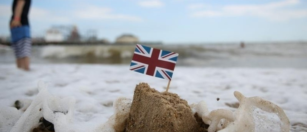 A sand castle is washed away by the sea in Clacton-on-Sea, a town in eastern England, where 70 percent of people voted on June 23, 2016 to leave the European Union, Britain August 22, 2016.