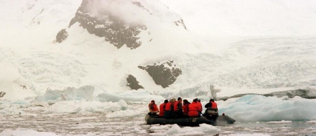 -UNDATED FILE PHOTO - Tourists take a zodiac ride around Cuerva Cove on the Antarctic peninsula, a popular landing site for the around 10,000 tourists that will visit the fragile ecosystem of the frozen continent this summer season, the highest number yet, raising concerns about the potential damage of increasing tourism. - PBEAHULWVDK