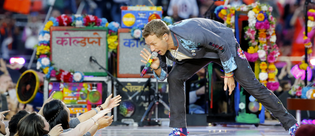 Chris Martin, lead singer of Coldplay, performs during the half-time show at the NFL's Super Bowl 50. The band will stop touring for now.