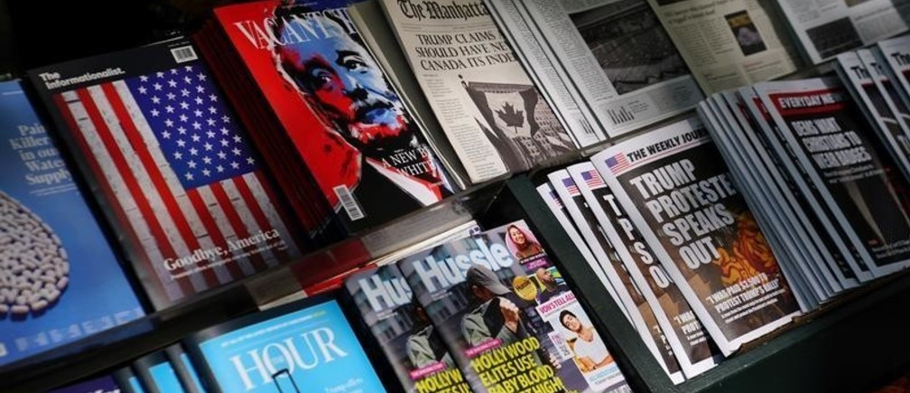 """A news stand outfitted with """"Fake News"""" headlines as a stunt pulled off by the Columbia Journalism Review is pictured in the Manhattan borough of New York, New York, U.S., October 30, 2018. REUTERS/Carlo Allegri - RC1A03704C60"""