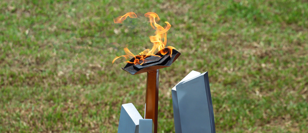 The flame of hope burns during a commemoration ceremony of the 25th anniversary of the genocide at the Genocide Memorial in Gisozi in Kigali, Rwanda April 7, 2019.REUTERS/Baz Ratner - RC155E591C20