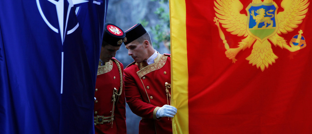 Montenegrin guard of honor inspect NATO and Montenegro flags prior to a ceremony to mark the accession to NATO of Montenegro in Podgorica, Montenegro, June 7, 2017. REUTERS/Stevo Vasiljevic - RTX39II4