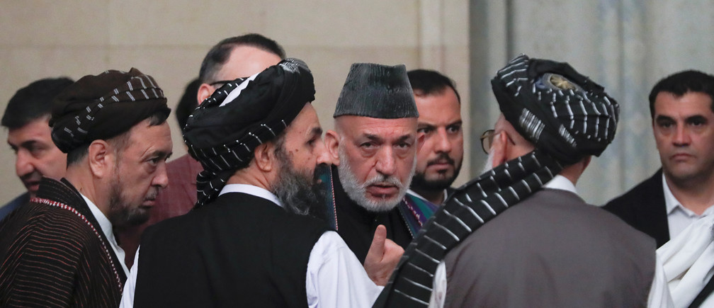 Officials, including Afghan former President Hamid Karzai (2nd R, front), Head of Political Office of Taliban Mohammad Abbas Stanikzai (R, front) and Taliban chief negotiator Mullah Abdul Ghani Baradar (3rd R, front), attend peace talks in Moscow, Russia May 30, 2019. REUTERS/Evgenia Novozhenina - RC1ECCC9D730