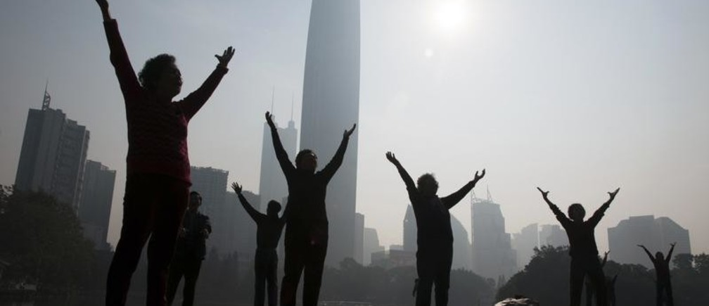 "Residents do morning exercises at a park on a hazy day in Shenzhen, Guangdong province February 12, 2015. Nearly 90 percent of China's big cities failed to meet air quality standards in 2014, but that was still an improvement on 2013 as the country's ""war on pollution"" began to take effect, the environment ministry said on February 2. REUTERS/Stringer (CHINA - Tags: ENVIRONMENT SOCIETY) CHINA OUT. NO COMMERCIAL OR EDITORIAL SALES IN CHINA - RTR4P8T4"
