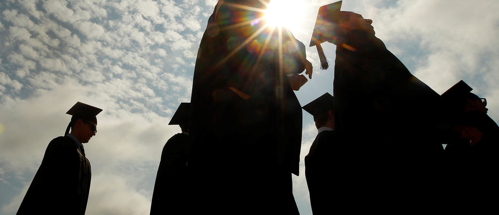 FILE PHOTO: Graduating students arrive for Commencement Exercises at Boston College in Boston, Massachusetts, U.S. on May 20, 2013. REUTERS/Brian Snyder/File Photo - RC1E6669FA00