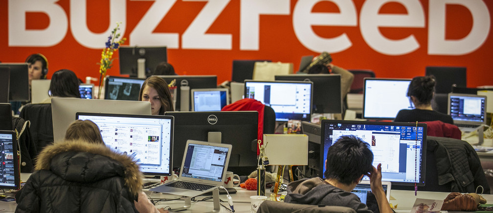 Buzzfeed employees work at the company's headquarters in New York January 9, 2014.