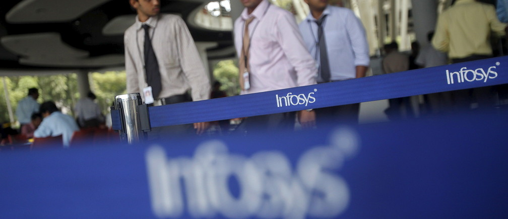 Employees of Indian software company Infosys walk past Infosys logos at their campus in the Electronic City area in Bangalore in this September 4, 2012 file photo.  REUTERS/Vivek Prakash/Files         GLOBAL BUSINESS WEEK AHEAD PACKAGE- SEARCH 'BUSINESS WEEK AHEAD APRIL 11' FOR ALL IMAGES - RTX29CXU
