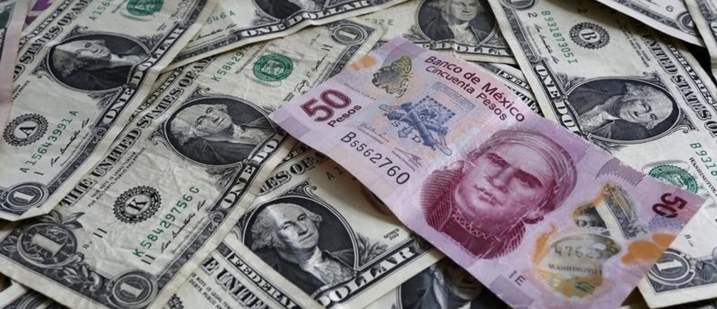 A picture illustration shows Mexican pesos and U.S. dollars banknotes in Mexico City July 6, 2015. Latin American currencies weakened on Monday after Greece overwhelmingly rejected a bailout offer from creditors, though moves were muted as investors bet the fallout would be limited. Nearly every currency dropped against the dollar. Equities markets were broadly lower, with the MSCI Latin American stock index falling for the second straight session. REUTERS/Edgard Garrido  - GF10000150887