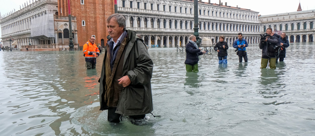 The Mayor of Venice Luigi Brugnaro walks on St Mark's Square during an exceptionally high water levels in Venice, Italy November 13, 2019. REUTERS/Manuel Silvestri - RC29AD9VIB5S