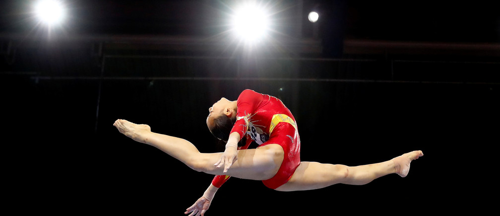Artistic Gymnastics - 2019 World Artistic Gymnastics Championships - Women's Qualifications - Balance Beam - Hanns-Martin-Schleyer-Halle, Stuttgart, Germany - October 4, 2019  China's Tang Xijing in action      REUTERS/Wolfgang Rattay - RC12A95F4C90