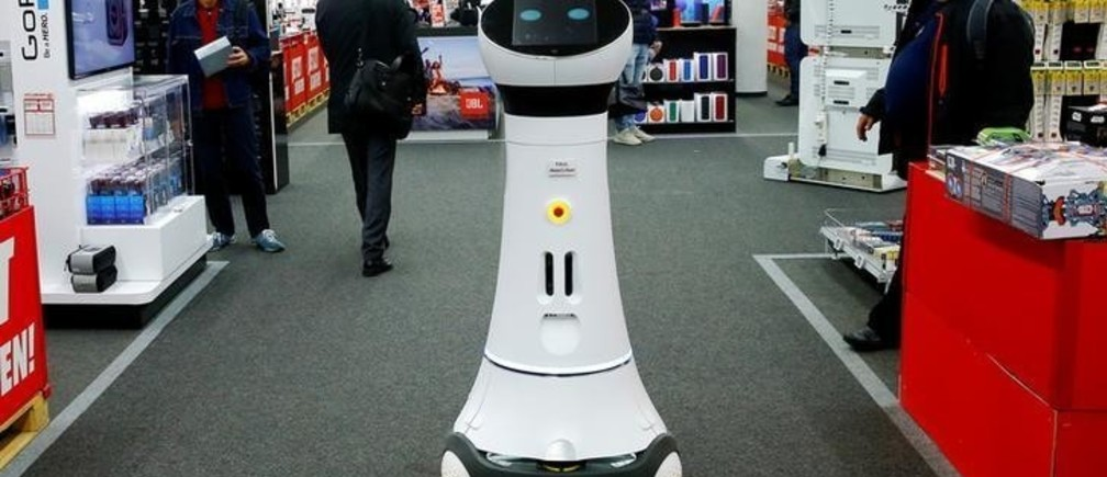 "A robot named ""Paul"", which can be used by customers to find products, is seen at a store of electronics retailer Media Markt in Zurich, Switzerland October 6, 2017. REUTERS/Arnd Wiegmann"