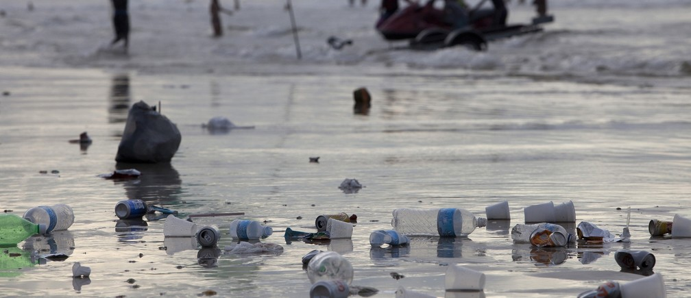 Trash is left scattered along Atalaia beach during the peak of the summer vacation season in Salinopolis, Para state, July 27, 2014.