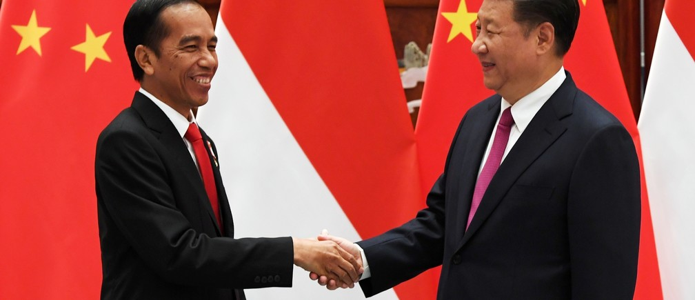Chinese President Xi shakes hands with his Indonesian counterpart Widodo ahead of the G20 Summit in Hangzhou, Zhejiang Province, China.