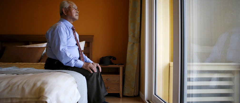 Park Jong-hwan, 80, who is selected as a participant for a reunion, rests at a hotel used as a waiting place in Sokcho, South Korea, October 19, 2015. The reunion of 90 South Koreans and 96 North Koreans, the 20th of its kind, will be held at a resort in the North, mostly in a large ballroom under the watchful eye of officials. The reunions are politically important for the South, where 66,000 people are on a waiting list to see long-lost relatives, a number that is shrinking fast, while the North also seeks to maximise their domestic propaganda value. REUTERS/Kim Hong-Ji - RTS51QE
