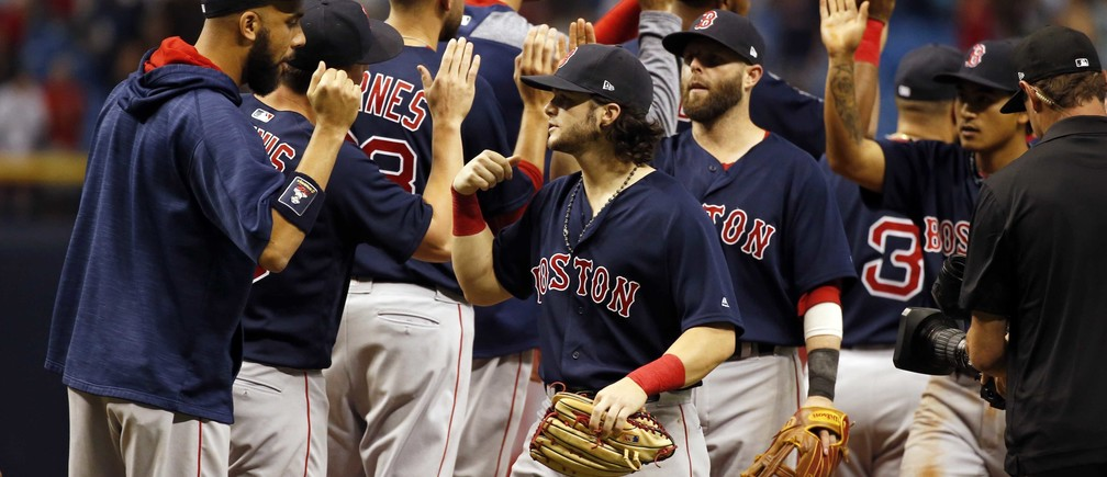 Jul 7, 2017; St. Petersburg, FL, USA; Boston Red Sox left fielder Andrew Benintendi (16), pitcher David Price (24), second baseman Dustin Pedroia (15) and teammates celebrate as they beat the Tampa Bay Rays at Tropicana Field. Mandatory Credit: Kim Klement-USA TODAY Sports - RTX3AL1S