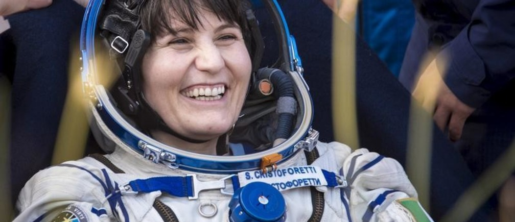 """International Space Station crew member Samantha Cristoforetti of Italy rests shortly after landing near the town of Zhezkazgan, Kazakhstan, June 11, 2015. Three astronauts landed safely in the steppes of Kazakhstan on Thursday, ending their 199-day mission after an unexpected """"bonus month"""" aboard the International Space Station, NASA Television showed. REUTERS/Bill Ingalls/NASA/Handout via Reuters ATTENTION EDITORS - THIS PICTURE WAS PROVIDED BY A THIRD PARTY. REUTERS IS UNABLE TO INDEPENDENTLY VERIFY THE AUTHENTICITY, CONTENT, LOCATION OR DATE OF THIS IMAGE. FOR EDITORIAL USE ONLY. NOT FOR SALE FOR MARKETING OR ADVERTISING CAMPAIGNS. THIS PICTURE IS DISTRIBUTED EXACTLY AS RECEIVED BY REUTERS, AS A SERVICE TO CLIENTS - GF10000124261"""