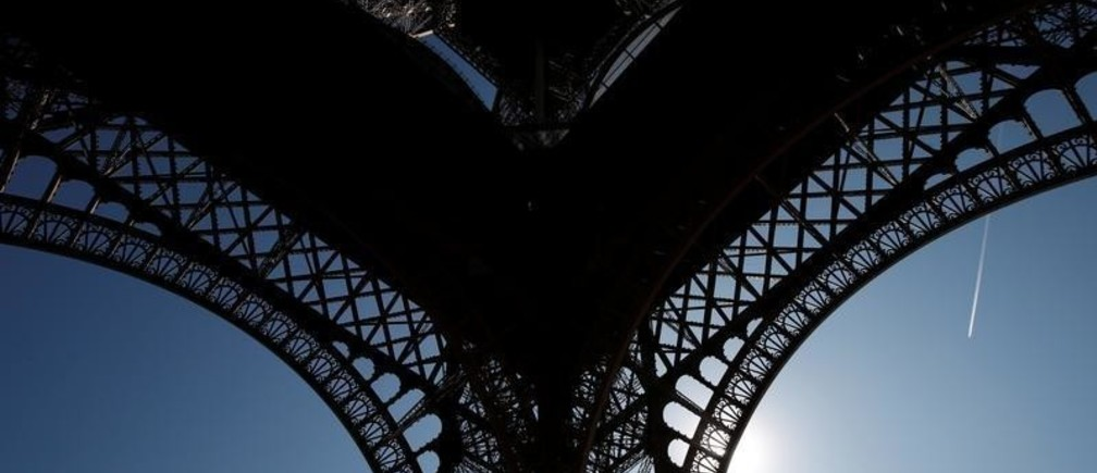 The Eiffel Tower is seen in silhouette as hot summer temperatures continue, with heat wave alerts in parts of the country, in Paris, France, August 2, 2018.  REUTERS/Benoit Tessier - RC140D2C6FD0
