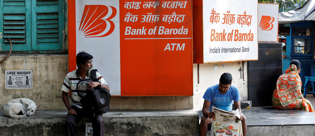 People sit outside Bank of Baroda's branch in Kolkata, India May 16, 2017. Picture taken May 16, 2017. REUTERS/Rupak De Chowdhuri - RTX36FDR