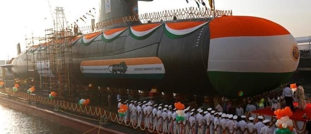 A priest performs rituals before the launch of India's third Scorpene-class submarine INS Karanj at the Mazagon Dock Ltd. naval ship building yard, in Mumbai, India January 31, 2018. REUTERS/Shailesh Andrade
