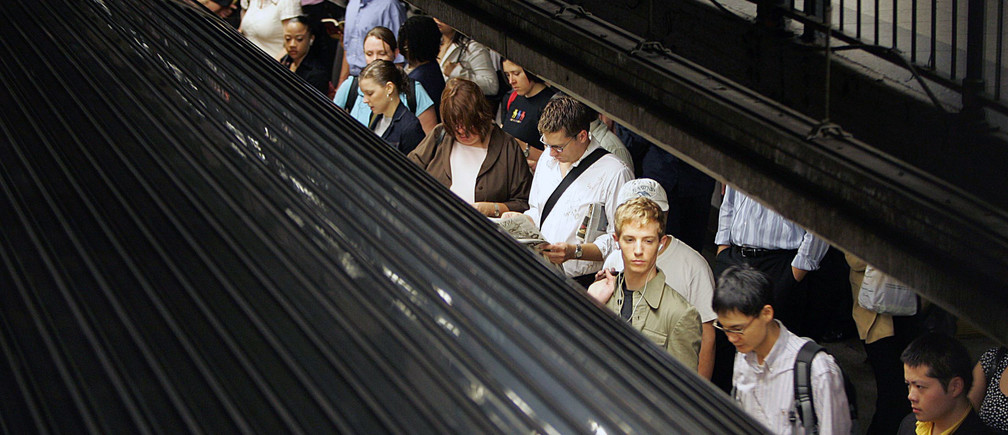 Commuters wait for the subway train to stop in New York City October 7, 2005. Part of the section of New York's Pennsylvania Station where Amtrak trains operate was sealed off on Friday morning because of what authorities said was a police situation, a day after officials warned of a possible attack on the system. The precaution came one day after New York officials said they had intelligence that the city's subway system was under a credible and specific threat of possible attack. REUTERS/Seth Wenig - RP2DSFIMBZAA