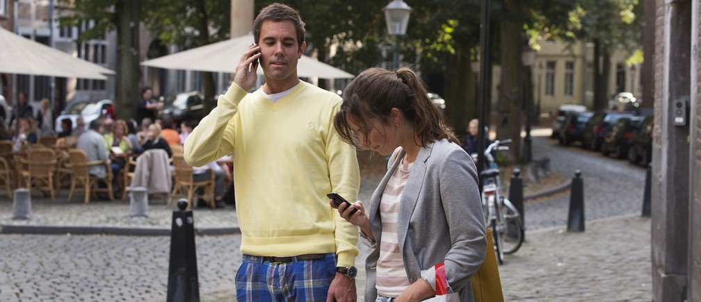 A couple uses their smartphones on the streets of Maastricht September 15, 2012.