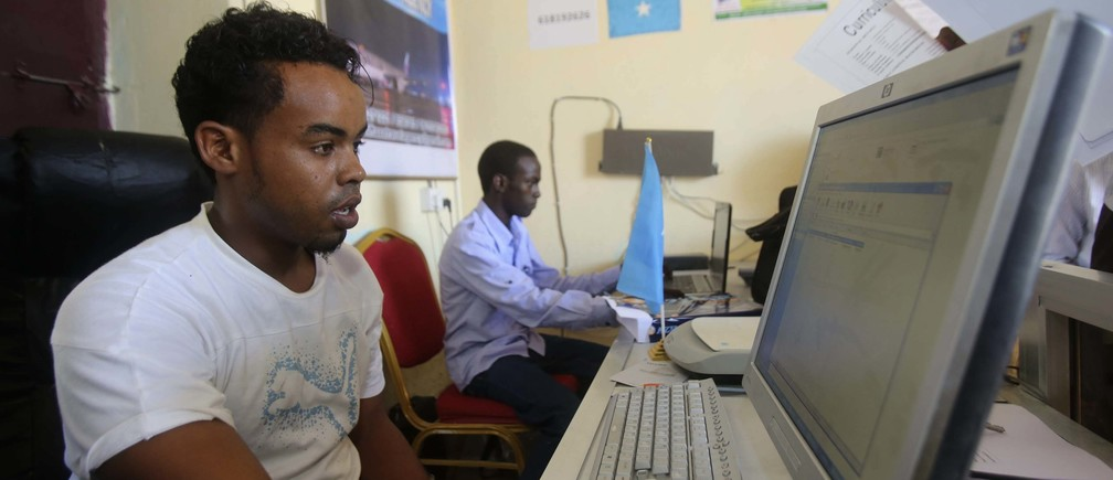 An internet cafe manager uses a computer in an internet cafe in the Hodan area of Mogadishu October 9, 2013. Reuters/Feisal Omar (SOMALIA - Tags: SOCIETY) - RTX14IOC