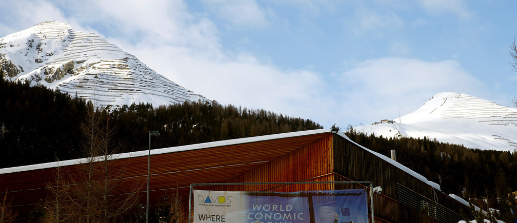 A banner of the World Economic Forum (WEF) is seen in front of the congress center in the Swiss mountain resort of Davos, Switzerland, January 11, 2018  REUTERS/Arnd Wiegmann - RC1CBF1685B0