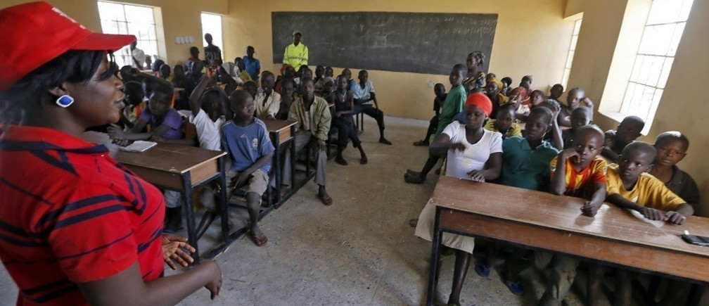 Children displaced as a result of Boko Haram attacks in the northeast region of Nigeria, attend class at Maikohi secondary school inside a camp for internally displaced persons (IDP) in Yola, Adamawa State January 13, 2015.